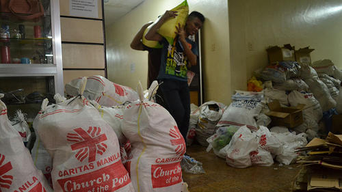Delivering aid to the victims of Typhoon Haiyan