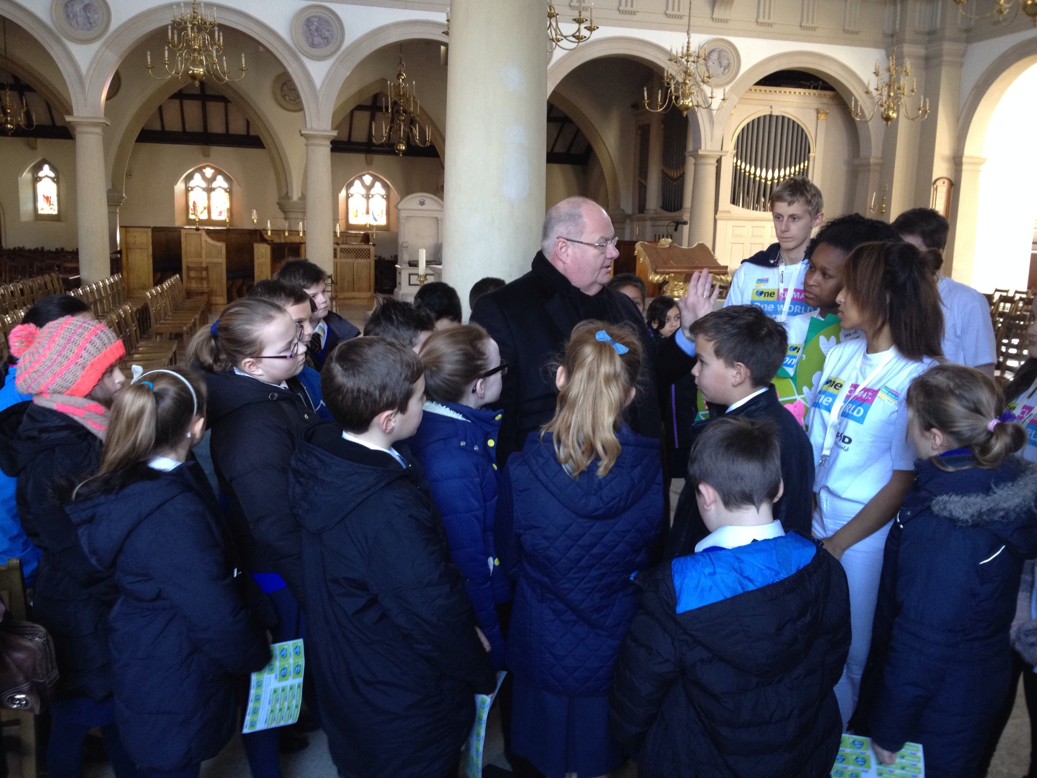 Eric Pickles MP answering questions on climate change from young CAFOD supporters at Brentwood Cathedral