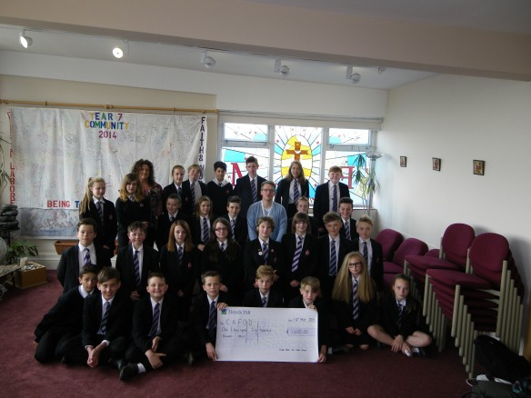 Children from Fisher More present the Cheque to Dominic