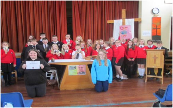 St Cecilia's CAFOD Link Group proudly show their   CAFOD Salford Award