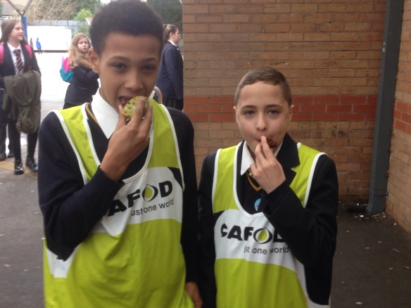 Students eating cake bought for CAFOD's Lent Appeal