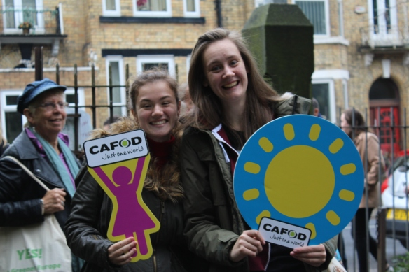 Volunteers hold CAFOD signs